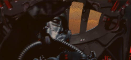 The TIE pilot throws his arms up in alarm !
