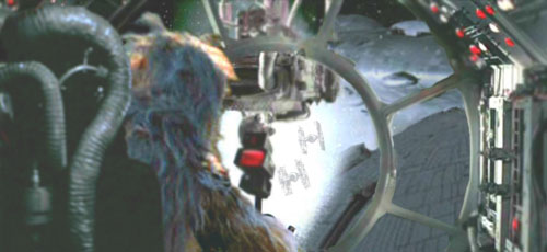 Chewie roars triumphantly as the pursuing TIEs and the reactor support brace explode.