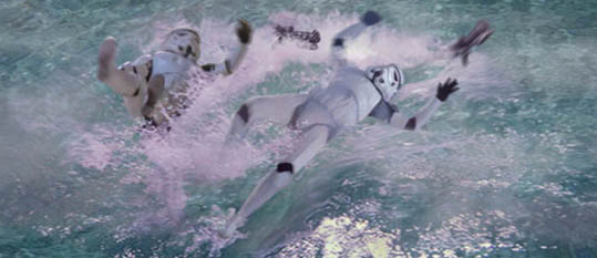 Artwork by Scott : A bathing Hutt patron slaps down two stormtroopers into the water with his mighty tail.