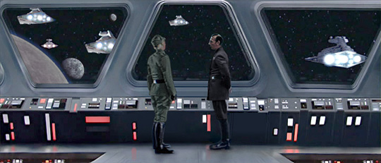An aide notifies Commander Kane of an incoming communiqué. Artwork by Scott.